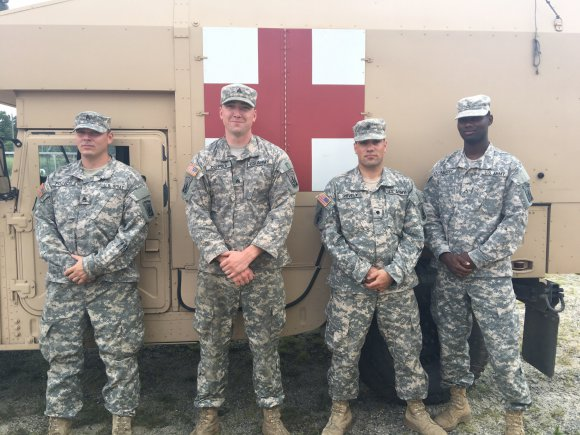 Photo by U.S. Army Staff Sgt. Steven Littlefield (from left) Massachusetts National Guard Soldiers Staff Sgt. Dana Francis