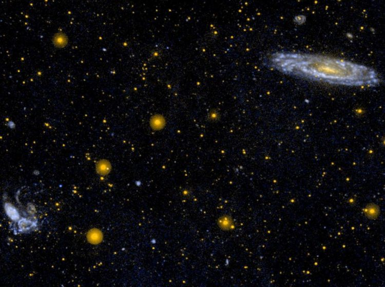 This ultraviolet image from NASA's Galaxy Evolution Explorer is of the interacting group of galaxies known as Stephan's Quintet (NGC 7317, NGC 7318A, NGC 7318B, NGC 7319, NGC 7320, lower left).