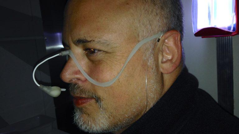 STEAMworkPHILLY's Dan Schimmel wearing the GhostFood device. (Zack Seward/WHYY)