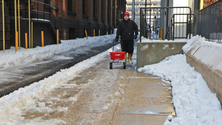 Old City sidewalks get salted. (Kimberly Paynter/WHYY, file)