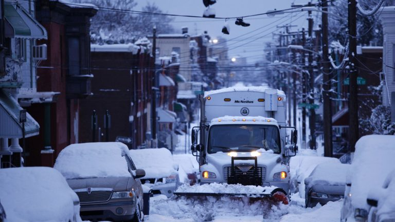 A city truck plows snow from the street during a winter storm in Philadelphia. (AP Photo/Matt Rourke)