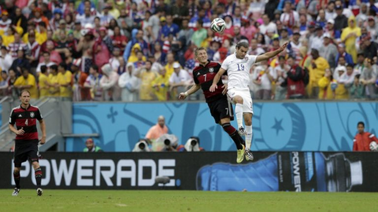 Bastian Schweinsteiger (7) of Germany and Graham Zusi (19) of USA during the group G World Cup soccer match between the USA and Germany at the Arena Pernambuco in Recife, Brazil, Thursday, June 26, 2014. (AP Photo/Matthias Schrader)