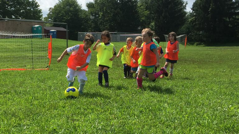 Young soccer players practice during the University of Delaware's summer camp for kids in Newark. (Zoe Read/WHYY)