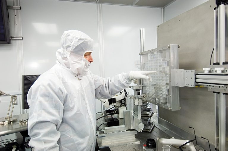 Andrew Westphal analyzes a sample of dust particles brought back from a mission on the Stardust spacecraft. (Photo courtesy of Andrew Westphal/NASA)