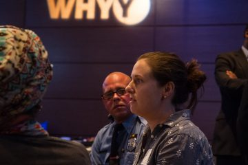 Neighborhood leaders, city employees, a few police officers, and citizens who simply wanted to learn more attended a community policing forum at WHYY on Nov. 17. (Ifanyi Bell/for NewsWorks)