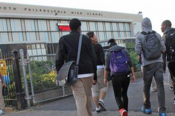 Students arrive for the first day at South Philadelphia High School. School officials are trying to ease concerns that receiving students from the now-closed Bok Technical High School will cause tension in the school. (Kimberly Paynter/WHYY)