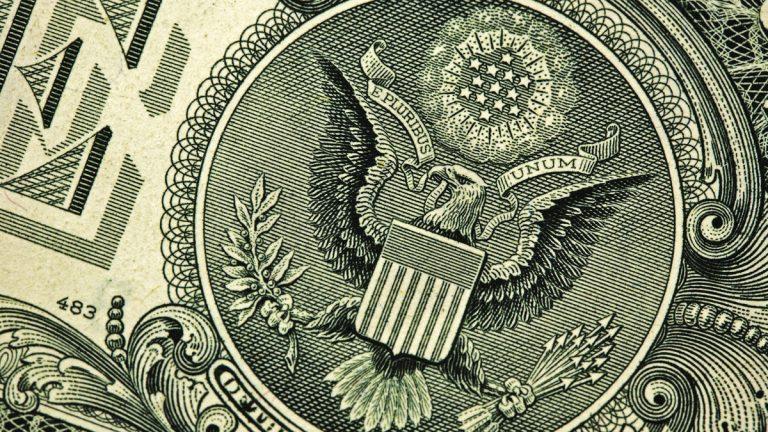 "(<a href=""http://www.shutterstock.com/pic-78312304/stock-photo-back-of-one-dollar-bill.html?src=yy0QbGbUJ2a81iobIuj_iw-1-39"">Photo</a> via ShutterStock)"