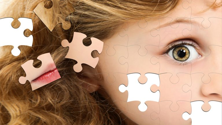 """(<a href=""""http://www.shutterstock.com/pic-67145764/stock-photo-close-up-of-profile-child-puzzle-pieces-on-white-table.html?src=UAT4ikYbX3SrkeCLYaz4Lw-1-78"""