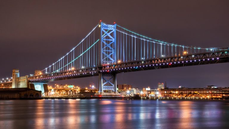 The Ben Franklin Bridge illuminated over the Delaware River (<a href=