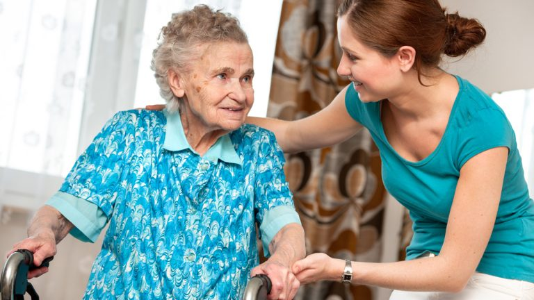 """(<a href=""""http://www.shutterstock.com/pic-126466499/stock-photo-senior-woman-with-her-caregiver-at-home.html?src=pp-photo-111443765-AJngCnDh3yURKbv2LWb93g-6&ws=1"""">Photo</a> via ShutterStock)"""