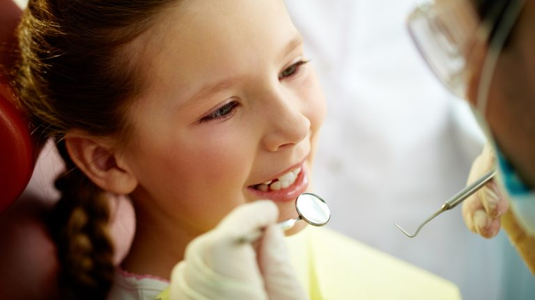 "(<a href=""http://www.shutterstock.com/pic-99581816/stock-photo-close-up-portrait-of-a-little-smiling-girl-at-dentist-s-office.html?src=WmWycw1ykzkLxfs-gQmFRw-1-65"">Photo</a> via ShutterStock)"