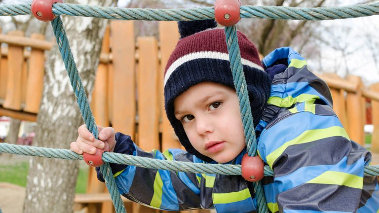 "(<a href=""http://www.shutterstock.com/pic-352406162/stock-photo-child-playing-at-children-playground-climbing-the-rope-ladder-frame.html?src=JfIwRBS-S95ZwtGpbt3CzA-1-77"">Photo</a> via ShutterStock)"