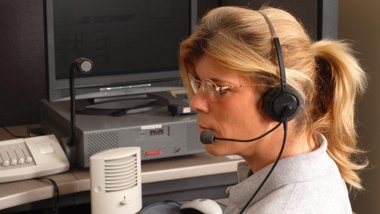 "(<a href=""http://www.shutterstock.com/pic-3186272/stock-photo-a-police-dispatcher-sitting-at-a-dispatch-console.html?src=f5A8d64JsY4qEV8_CxRZSg-1-2"">Photo</a> via ShutterStock)"
