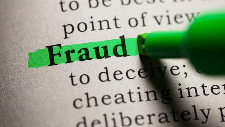 "(<a href=""http://www.shutterstock.com/pic-183938708/stock-photo-fake-dictionary-definition-of-the-word-fraud.html?src=3utWr7DBHXvsqSPyxK-wJw-1-77"">Photo</a> via ShutterStock)"