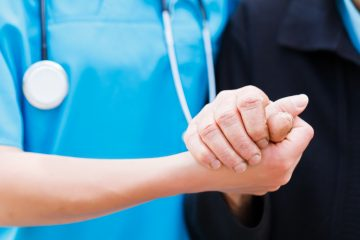 """(<a href=""""http://www.shutterstock.com/pic-140404582/stock-photo-caring-nurse-or-doctor-holding-elderly-lady-s-hand-with-care.html?src=GnTfmErksevvrgEh3ib39A-1-1"""">Photo</a> via ShutterStock)"""