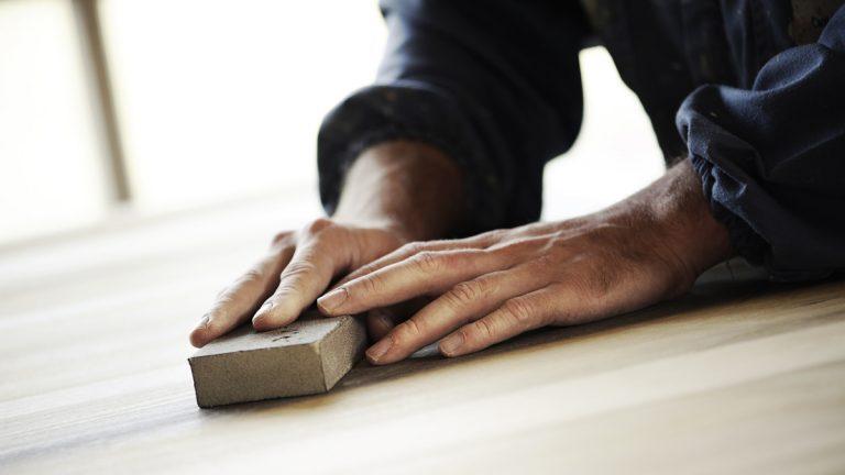 "(<a href=""http://www.shutterstock.com/pic-175533020/stock-photo-professional-carpenter-sanding-and-refinishing-wood-surface.html?src=u911vGfvZF7KM4EICSUu0w-1-13"">Photo</a> via ShutterStock)"