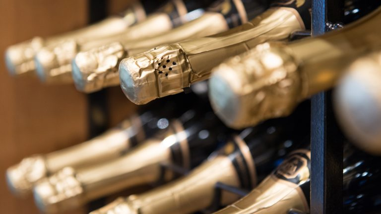 """(<a href=""""http://www.shutterstock.com/pic-163375529/stock-photo-sparkling-wine-champagne-bottles-close-up.html?src=UT9cqumd_IvuYdpS8-dH5Q-1-12"""">Photo</a> via ShutterStock)(<a href=""""http://www.shutterstock.com/pic-163375529/stock-photo-sparkling-wine-champagne-bottles-close-up.html?src=UT9cqumd_IvuYdpS8-dH5Q-1-12"""">Photo</a> via ShutterStock)"""