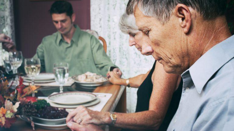 "(<a href=""http://www.shutterstock.com/pic-325633142/stock-photo-thanksgiving-family-says-prayer-before-dinner.html?src=99rXkjNuGoiIEPwEtAUR-A-1-1"">Photo</a> via ShutterStock)"