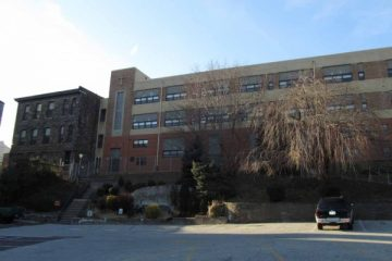 A plan to turn the St. Bridget school into a 32-unit apartment building was first proposed in November. (Megan Pinto/WHYY, file)