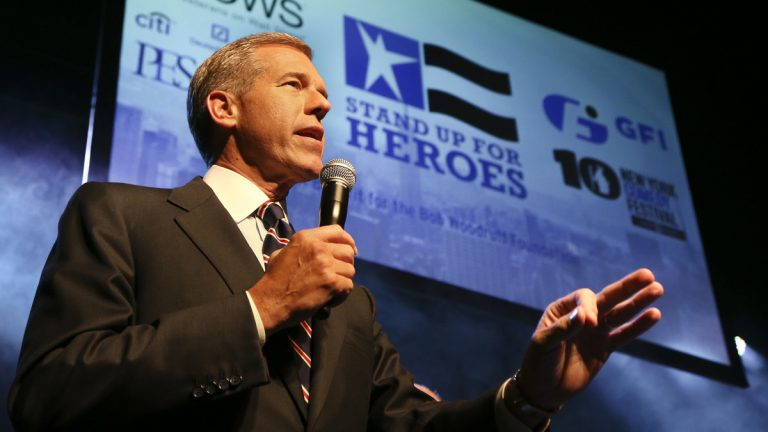 NBC News anchor Brian Williams speaks to the audience at the Stand Up for Heroes event at Madison Square Garden in 2013. (John Minchillo/InvisionAP)
