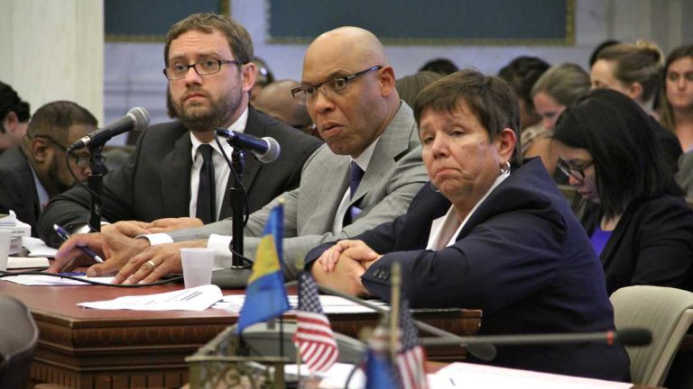Among the high ranking administrators to leave the Philadelphia School District is Chief Financial Officer Matthew Stanski, left, shown here at a City Hall budget hearing with Superintendent William Hite and SRC Chair Marjorie Neff. (NewsWorks file photo)