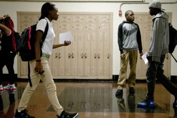 Students check in as they arrive at a new high school called The LINC, which stands for Learning in New Contexts in Philadelphia. (AP Photo/Matt Rourke)