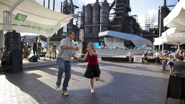 Jim Jacek and Kathy Fox dance during a free jazz performance outside of ArtsQuest and the Levitt Pavilion at SteelStacks