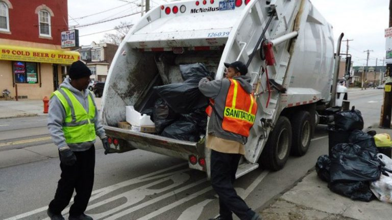 Philadelphia sanitation workers on their route. (Image courtesy of Philadelphia Streets Department)