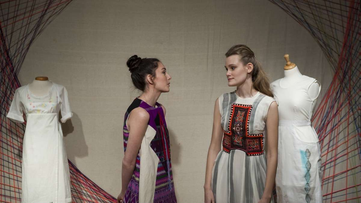 Models Lizzie Norton (left) and Alex Rader chat while wearing designs by Senpai , Kohai at the Style Social and Fashion Designer Launch party in Manayunk Wednesday evening. (Tracie Van Auken/for NewsWorks)