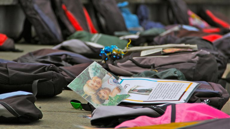 The Send Suicide Packing exhibit included more than 1,000 backpacks decorated with photographs, personal possessions, and memorial messages of suicide victims and their families. (NewsWorks file photo)
