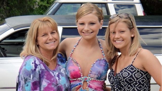 (From left) Carolyn Coburn with her daughters Samantha and Megan, before prom Samantha's sophomore year of high school. Samantha took her own life a year ago. Carolyn and Megan have formed an organization, 'Spread the Love,' to combat teen suicide. (Image courtesy of Megan Coburn)