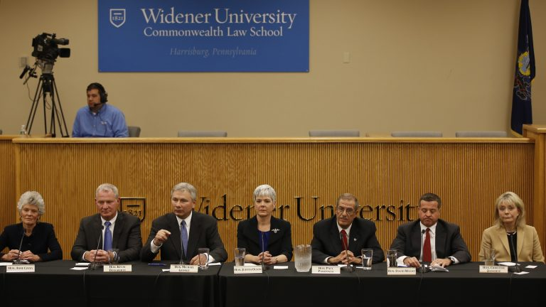 State Superior Court judge Christine Donohue, from right, state Superior Court Judge David Wecht, Philadelphia Judge Paul Panepinto, state Superior Court Judge Judith Olson, Adams County, Pa., Judge Michael George, Philadelphia Judge Kevin Dougherty and state Commonwealth Court Judge Anne Covey participate in a Pennsylvania Supreme Court debate, Wednesday, Oct. 14, 2015, at the Widener University Commonwealth Law School in Harrisburg, Pa. On Nov. 3, voters will fill three vacancies on the seven-member state Supreme Court. (AP Photo/Matt Slocum)
