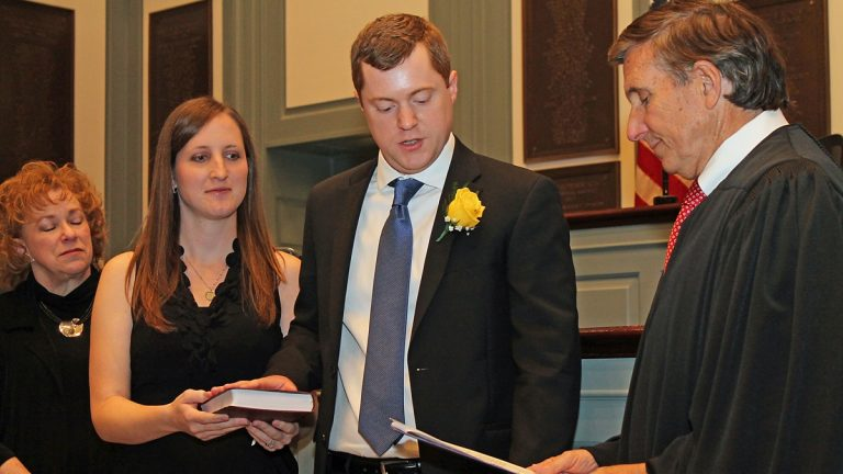 Rep. David Bentz takes the oath of office adminstered by Delaware Supreme Court Justice Randy Holland. Bentz's wife Sara holds the Bible. (photo courtesy Doug Denison)