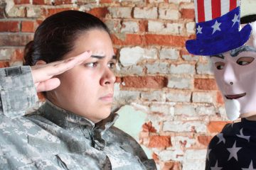 Gabriela Sanchez in the role of a soldier that has been sexually assaulted in the military in the play 'She Wore Those Boots' by Erlina Ortiz (Photo courtesy of Power Street Theater Company)