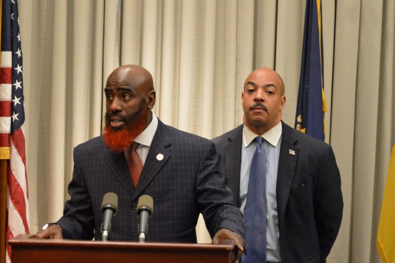 Philadelphia Deputy District Attorney Tariq El Shabazz and District Attorney Seth Williams discuss the shooting incident involving Officer Dorion Young. (Tom MacDonald/WHYY)