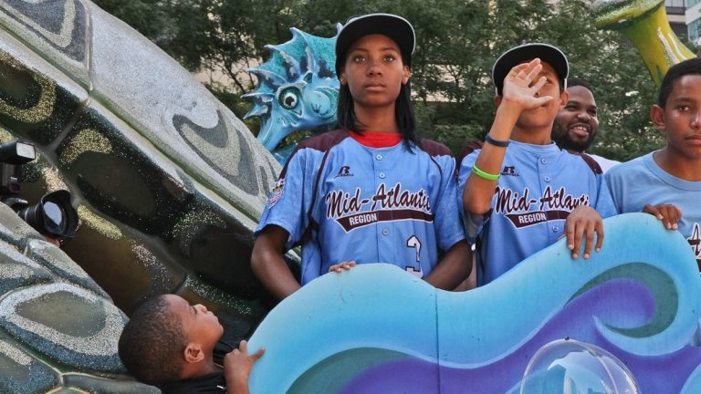 Taney star pitcher Mo'ne Davis rides in a parade celebrating the team after their return from the Little League World Series. (Kimberly Paynter/WHYY)