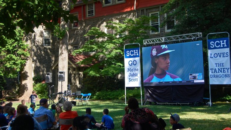 SCH Academy student Mo'ne Davis appears on the big screen at the school's watch party on Sunday. (Emily Brooks/for NewsWorks)