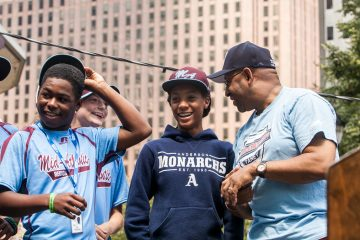 Pitcher Mo'ne Davis and her teammates laugh while chatting with Mayor Michael Nutter. (Brad larrison/for NewsWorks)