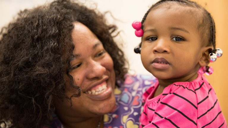 Barretta Freeman of Chester, with one of her children, is a pastparticipant in the Healthy Start program in DelawareCounty. (Image courtesy of Crozer-Keystone Health System)