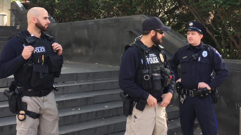Homeland Security agents patrol Temple University campus in response to a threat posted online. (Bobby Allyn/WHYY)