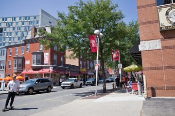 Temple University students, new student housing units, and restaurants occupy the heavily trafficked block on Cecil B. Moore Avenue just west of Broad Street. (Lindsay Lazarski/WHYY)