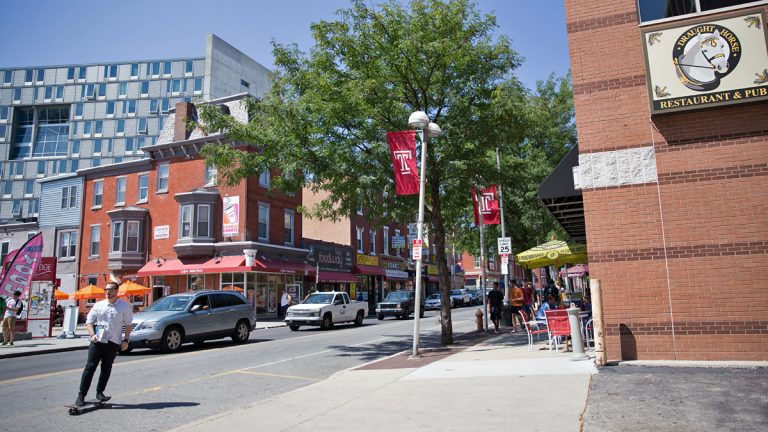 Temple University students, new student housing units, and restaurants  occupy the heavily trafficked block