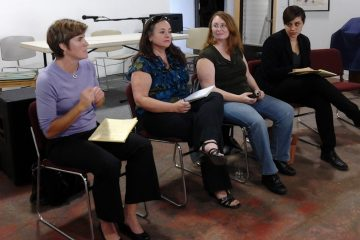 (L to R) Helen Casale, Tiffany Palmer, Mary Catherine Roper and Barrett Marshall speak on Sunday night's panel on same-sex marriage at Mt. Airy Art Garage. (Alaina Mabaso/for NewsWorks)