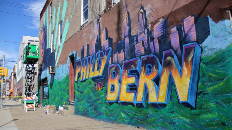 A mural going up at the corner of 22nd and Catherine streets promotes Democratic presidential candidate Bernie Sanders. (Emma Lee/WHYY)