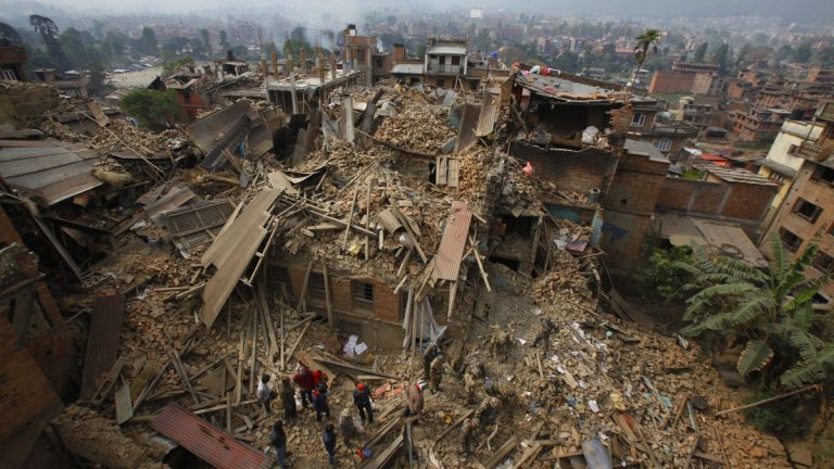 Rescue workers remove debris as they search for victims of earthquake in Bhaktapur near Kathmandu