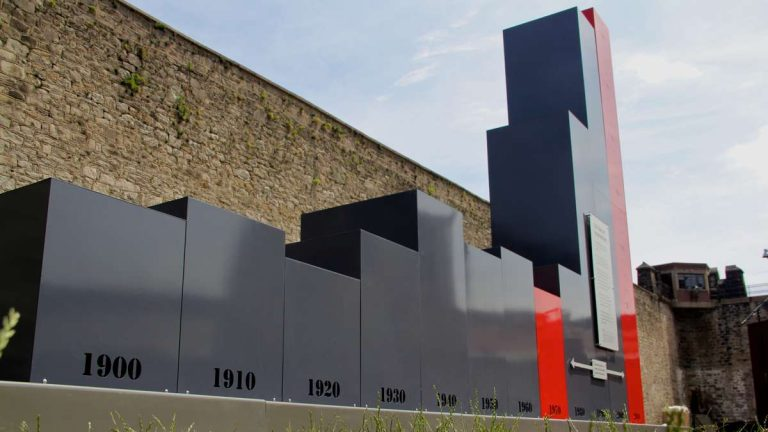 A permanent art installation in the prison yard at Eastern State Penitentiary illustrates the soaring U.S. incarceration rates since 1900. (Emma Lee/WHYY)