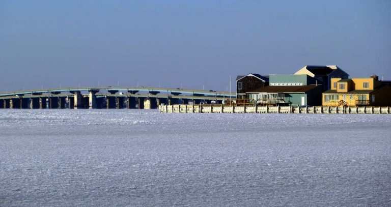 The frozen Barnegat Bay and the Mathis Bridge in the background as seen from Seaside Park on Jan. 7, 2014 by Kevin Michelson.
