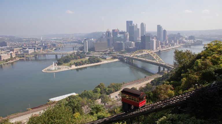 Pittsburgh experienced the most severe state and federal cuts of 30 cities examined by the Pew Charitable Trusts. Here, the city's downtown from the Duquesne Incline in the Mount Washington neighborhood. (Lindsay Lazarski/WHYY)