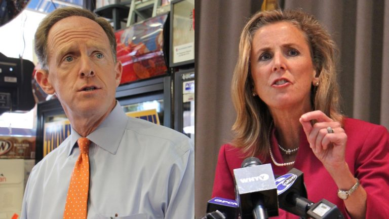 Republican Sen. Pat Toomey (left) and Democratic Senate candidate Katie McGinty on the campaign trail in Philadelphia.  (Emma Lee/WHYY)