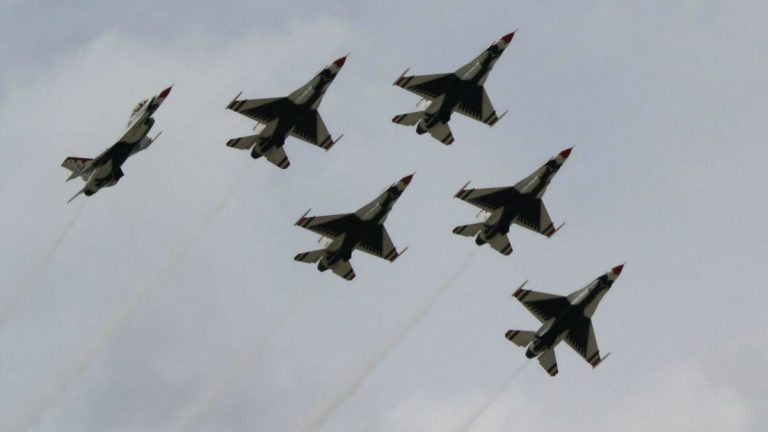 The U.S. Air Force Thunderbirds fly at Joint Base McGuire-Dix-Lakehurst in New Jersey in 2014. (Mark Eichmann/WHYY)